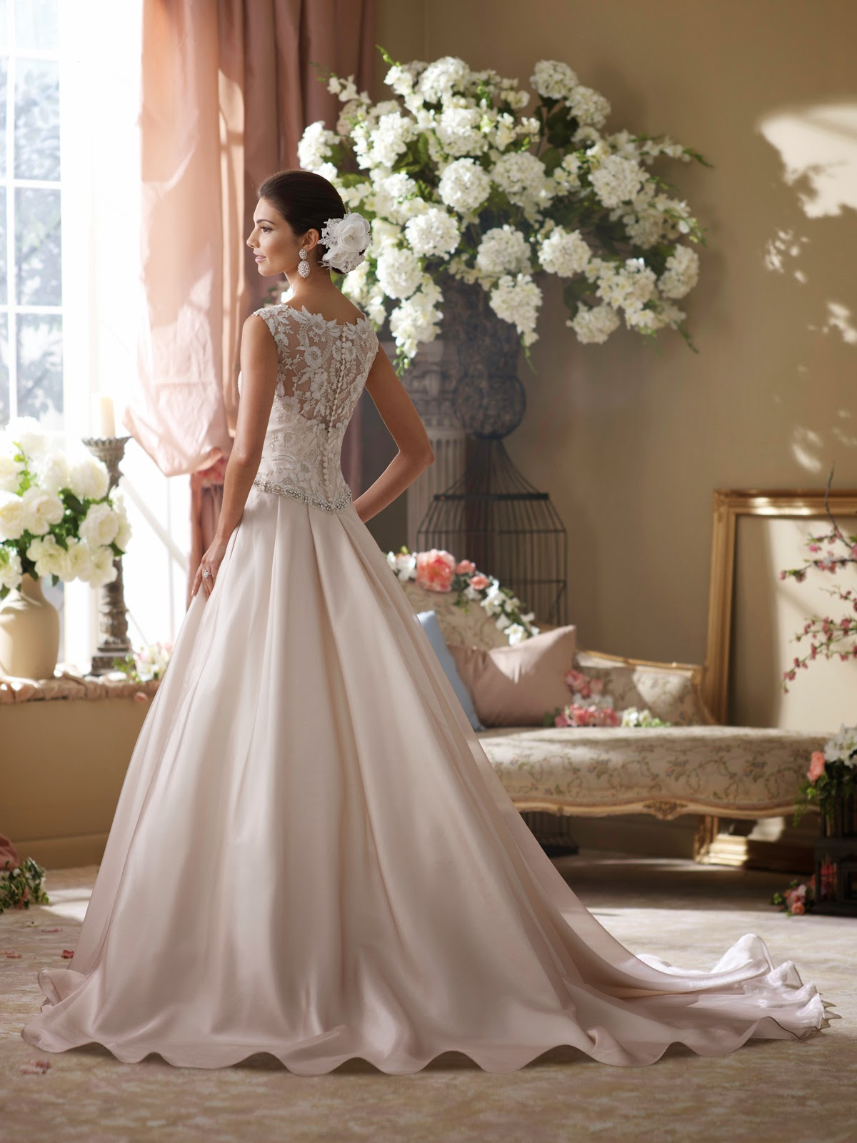 David's Bridal is credited with revolutionizing the bridal retail industry. After 50 years in the business, we introduced a new concept offering an innovative shopping option for modern brides-to-be: stores filled with a vast selection of designer wedding gowns, in stock, in every size.