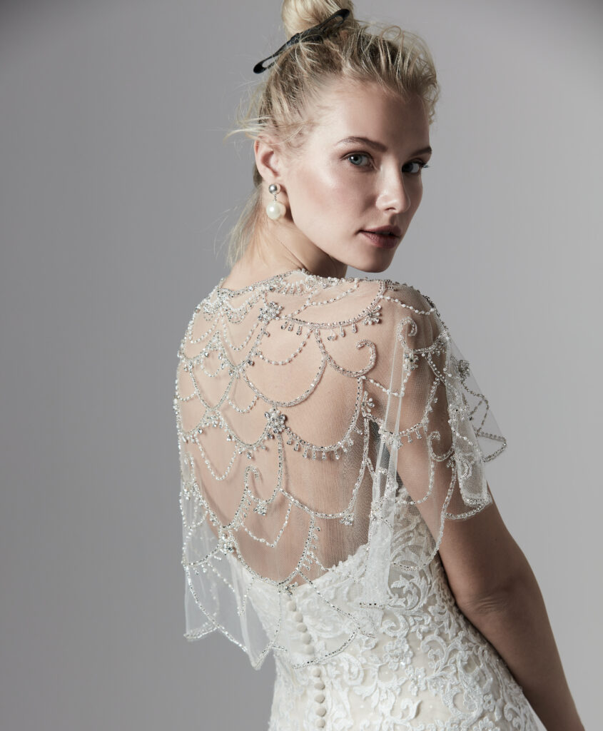 A zoomed in picture of the jeweled accessory on the Sottero and Midgley wedding dress to create two looks.